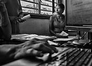 Camopi, Guyane, 2015.<br /> <br /> Pôle emploi. Citoyens français, les habitants de Camopi en ont les mêmes droits et les mêmes devoirs. L'obtention du Revenu de Solidarité Active ne les dispense pas de leurs obligations d'insertion. Régulièrement, ils se déplacent depuis leurs écarts sur le fleuve jusqu'au bureau dédié de la mairie pour effectuer des recherches sur d'hypothétiques emplois locaux et maintenir leur droit à l'allocation.
