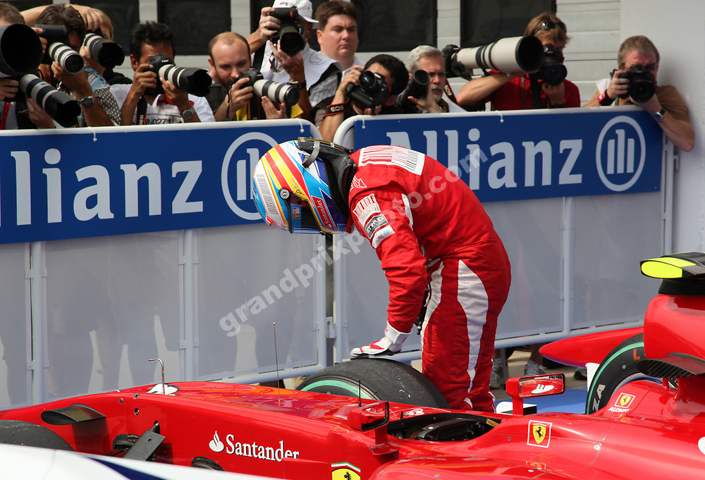Fernando Alonso (Ferrari) checks his tyres after qualifying for the 2010 Hungarian Grand Prix at the Hungaroring outside Budapest. Photo: Grand Prix Photo