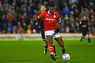 Dimitri Cavare of Barnsley (12) passes the ball during the EFL Sky Bet League 1 match between Barnsley and Sunderland at Oakwell, Barnsley, England on 12 March 2019.