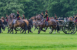 Hyde Park, London, June 2nd 2016. Soldiers and guns of the King's Troop Royal Horse Artillery fire a 41 round Royal Salute to mark the 63rd anniversary of the coronation of Britain's Monarch HM Queen Elizabeth II. PICTURED: Hooves thunder across the grass as the mounted troops arrive to tow away the guns.