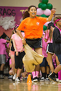 Milpitas High School freshman hops down the court during the potato sack race during the annual Trojan Olympics, where students compete in various unorthodox events for class bragging rights, at Milpitas High School in Milpitas, California, on March 27, 2015. (Stan Olszewski/SOSKIphoto)