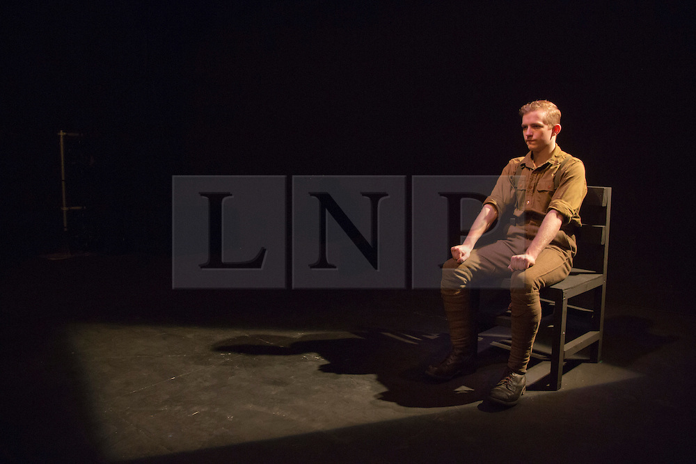 """© Licensed to London News Pictures. 23/05/2014. London, England. Actor Jack Holden performs in the one-man play """"Johnny Got His Gun"""". Metal Rabbit brings the UK premiere of Dalton Trumbo's anti-war novel """"Johnny Got His Gun""""  to Southwark Playhouse in an adaptation by Bradley Rand Smith. The play is directed by David Mercatali and marks the Centenary of the First World War. At Southwark Playhouse from 21 May to 14 June 2014. Photo credit: Bettina Strenske/LNP"""