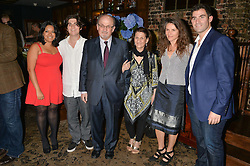 Left to right, MAYA RUSHDIE MOMEN, MILAN RUSHDIE, SIR SALMAN RUSHDIE, SAMEEN RUSHDIE, ELIZABETH WEST and ZAFAR RUSHDIE at a party to celebrate the engagement of Natalie Coyle and Zafar Rushdie held at Library, St.Martin's Lane, London on 6th September 2014.
