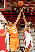 Jan 8, 2012; Fayetteville, AR, USA; Tennessee Lady Volunteers forward Bicki Baugh (21) attempts to block a shot made by Arkansas Razorbacks guard C'eira Ricketts (22) during a game at Bud Walton Arena. Tennessee defeated Arkansas 69-38. Mandatory Credit: Beth Hall-US PRESSWIRE