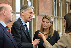 © Licensed to London News Pictures.  30/05/2017; Bristol, UK. General Election 2017; PHILIP HAMMOND, Chancellor of the Exchequer, visits Bristol Temple Meads railway station with THEO CLARKE (female) the Bristol East Conservative candidate. Picture credit : Simon Chapman/LNP