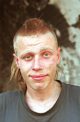 Portrait of homeless man with crew cut,