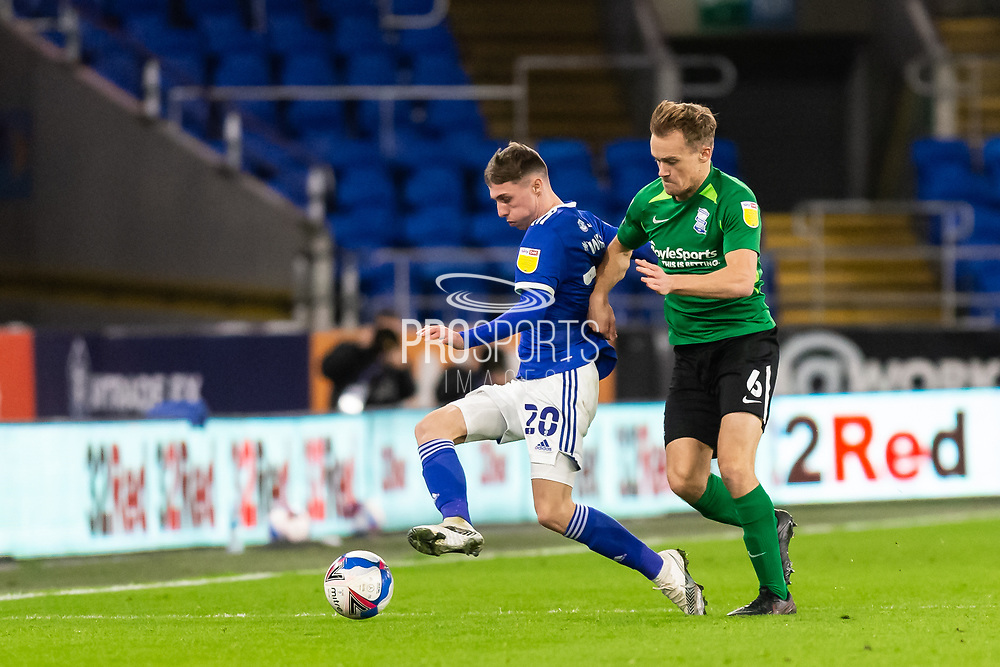 Cardiff City's Gavin Whyte (20) under pressure from Birmingham City's Maikel Kieftenbeld (6) during the EFL Sky Bet Championship match between Cardiff City and Birmingham City at the Cardiff City Stadium, Cardiff, Wales on 16 December 2020.