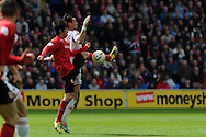 Cardiff city's Kim Bo-Kyung (l) battles for the ball with Bolton's Chris Eagles. NPower championship, Cardiff city v Bolton Wanderers at the Cardiff city Stadium in Cardiff, South Wales on Saturday 27th April 2013. pic by Andrew Orchard,  Andrew Orchard sports photography,
