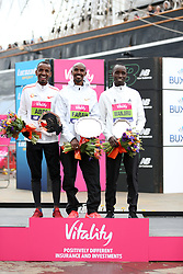 Mo Farah winner of the men's race (centre) with Bashir Abdi who finished secoond (left) and Daniel Wanjiru who finished third during the Vitality Big Half in London.