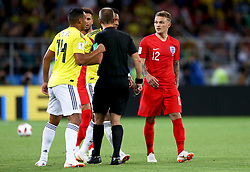 England's Kieran Trippier (right) reacts after being fouled by Colombia's Luis Muriel (left) during the FIFA World Cup 2018, round of 16 match at the Spartak Stadium, Moscow.