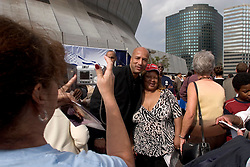 01 January, 2006. New Year's Day in New Orleans, Louisiana. <br /> Louisiana Rebirth interfaith service at the Superdome rings out the old disastrous 2005 and rings in what politicians and locals hope will be a successful 2006. Mayor Ray Nagin, rapidly becoming a celebrity in certain circles in New Orleans  poses with a survivor from the 9th ward. <br /> Photo; ©Charlie Varley/varleypix.com