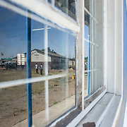 INDIVIDUAL(S) PHOTOGRAPHED: N/A. LOCATION: Chibolya Community School, Chibolya, Lusaka, Zambia. CAPTION: Learners are reflected in a window at Chibolya Community School in Lusaka. A block of classrooms was constructed at the school as part of Build It International's Training into Work & Community Building programme. Build It International is a charity that trains unemployed young people in Zambia to become builders, while at the same time building vital schools and clinics in communities with little or nothing by way of resources.
