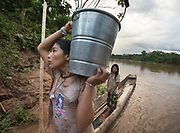 Fetching water. Evening bath of the Nate family.