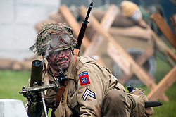 Reenactor portraying a US paratrooper from the 82nd Airborne crews a Mortar during a battle reenactment at Fort Paull Monday.7 May 2012.Image © Paul David Drabble