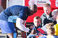 Adebayo Akinfenwa of Wycombe Wanderers (20) signs autographs for young fans before the EFL Sky Bet League 1 match between Barnsley and Wycombe Wanderers at Oakwell, Barnsley, England on 16 February 2019.
