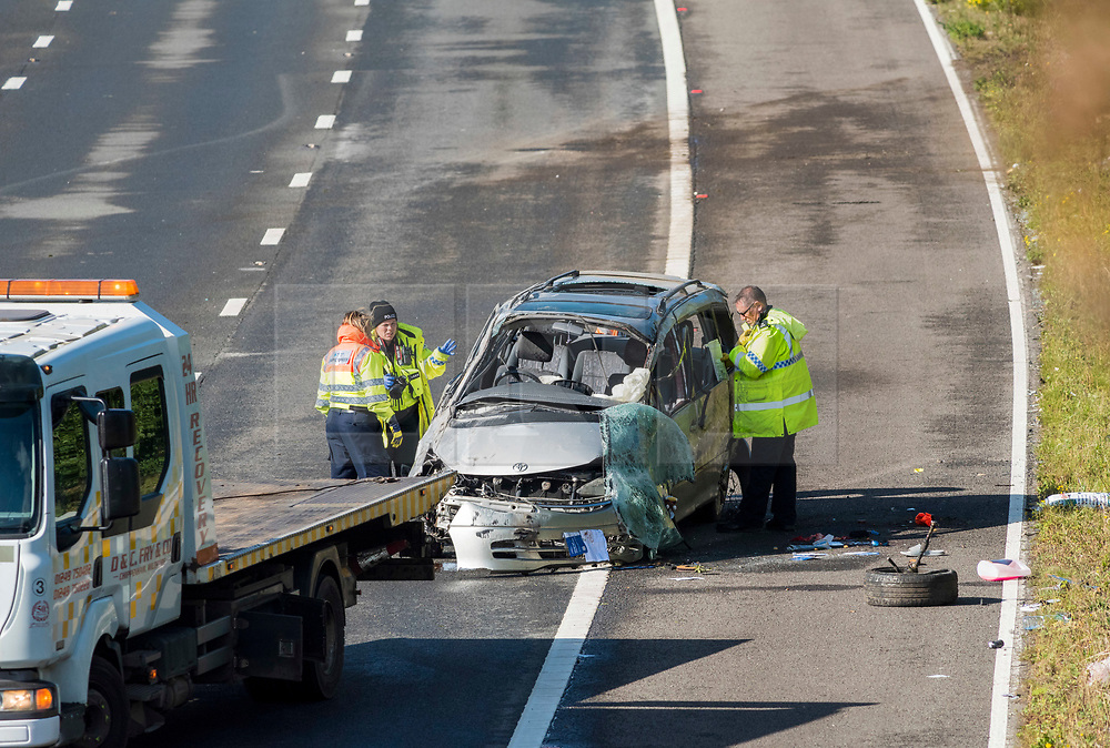 © Licensed to London News Pictures; 24/09/2020; M4, South Gloucestershire, UK. Accident investigators examine a damaged vehicle after the M4 motorway was shut in both directions when the car crashed and overturned during the night. News on casualties has not been released. Emergency services say two serious accidents on the M4 have caused the motorway to be shut and it may remain shut all morning, and have been long delays on diversion routes. Photo credit: Simon Chapman/LNP.
