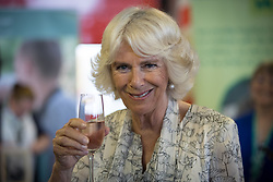 The Duchess of Cornwall tastes a locally produced wine at Newquay Fire Station, Cornwall, as she meets residents from Tregunnel Hill, a mixed-use neighbourhood built on Duchy of Cornwall land in Newquay comprising open-market and affordable homes.