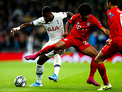 Serge Aurier of Tottenham Hotspur is challenged by Serge Gnabry of Bayern Munich - Rogan/JMP - 01/10/2019 - FOOTBALL - Tottenham Hotspur Stadium - London, England - Tottenham Hotspur v Bayern Munich - UEFA Champions League Group B.
