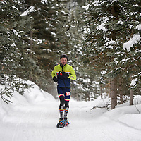 Third place men's soloist Corona Hadji sprints toward the finish of the snowshoe leg of the Mount Taylor Winter Quadrathlon in Grants Saturday.