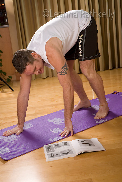 A man stretches before/during a workout.