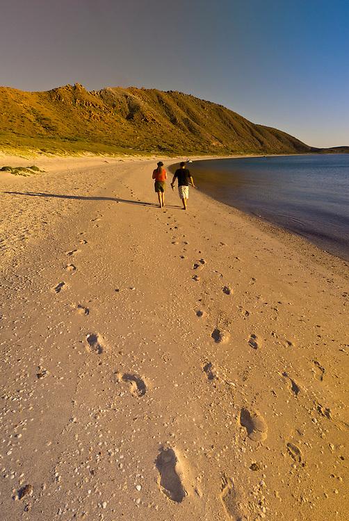 A couple walking on the beach, Isla San Francisco, Sea of Cortes, Baja California Sur, Mexico
