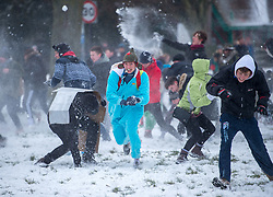 """© Licensed to London News Pictures. 02/03/2018. Bristol, UK. A mass snowball fight takes place on Bristol Downs in the snow from the """"Beast from the East"""" winter weather. Photo credit: Simon Chapman/LNP"""