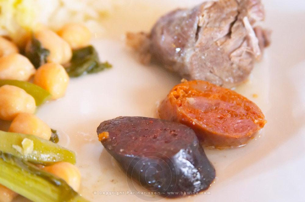In the restaurant. Sausages. Traditional beans, vegetable and meat stew. Herdade da Malhadinha Nova, Alentejo, Portugal