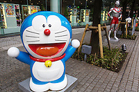 Doraemon is a Japanese manga series created by Fujiko Fujio, which became an anime series about a robotic cat named Doraemon who travels back in time to help the young boy Nobita Nobi.  More than 1300 stories were created published by Shogakukan in 45 volumes.
