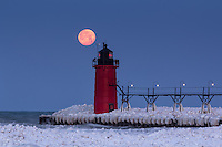 An icy January morning sees the full moon making its descent to the horizon