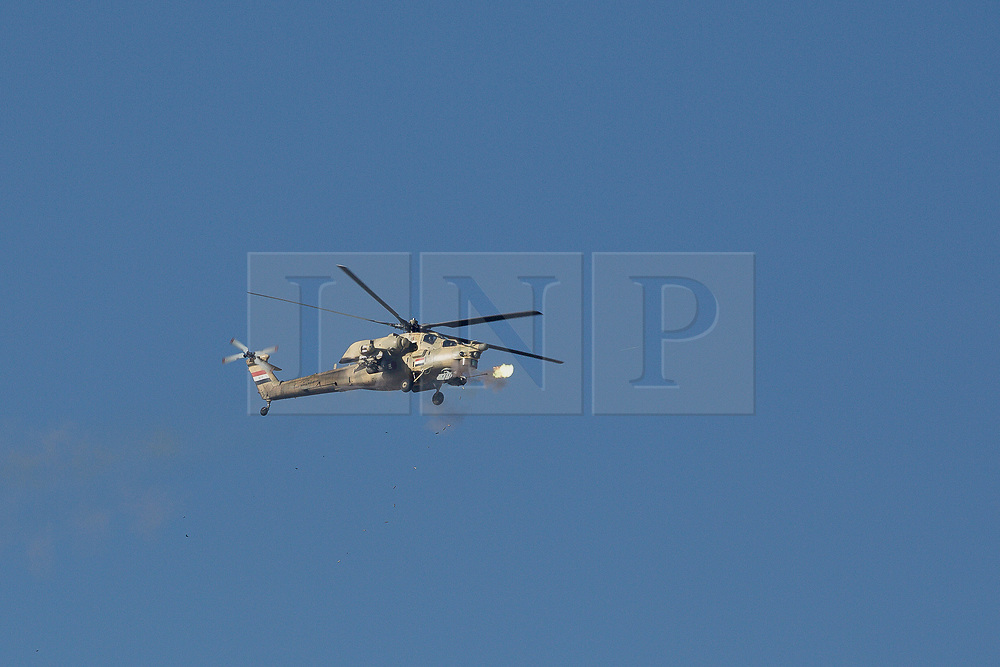 20/02/2017. Albu Saif, Iraq. An Iraqi Army Aviation Mi-28 attack helicopter fires its 30mm canon into the village of Albu Saif as Iraqi security forces continue with the offensive to retake western Mosul from Islamic State forces.<br /> <br /> Iraqi forces reported today that one of its attack helicopters, supporting the ongoing Mosul Offensive, was shot down by Islamic State militants.