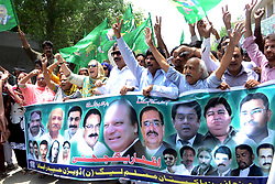 August 2, 2017 - Hyderabad, Sindh, Pakistan - Activists of PML-N holds a rally in favor of former PM and their party leader Nawaz Sharif outside the Hyderabad press club. (Credit Image: © Janali Laghari/Pacific Press via ZUMA Wire)