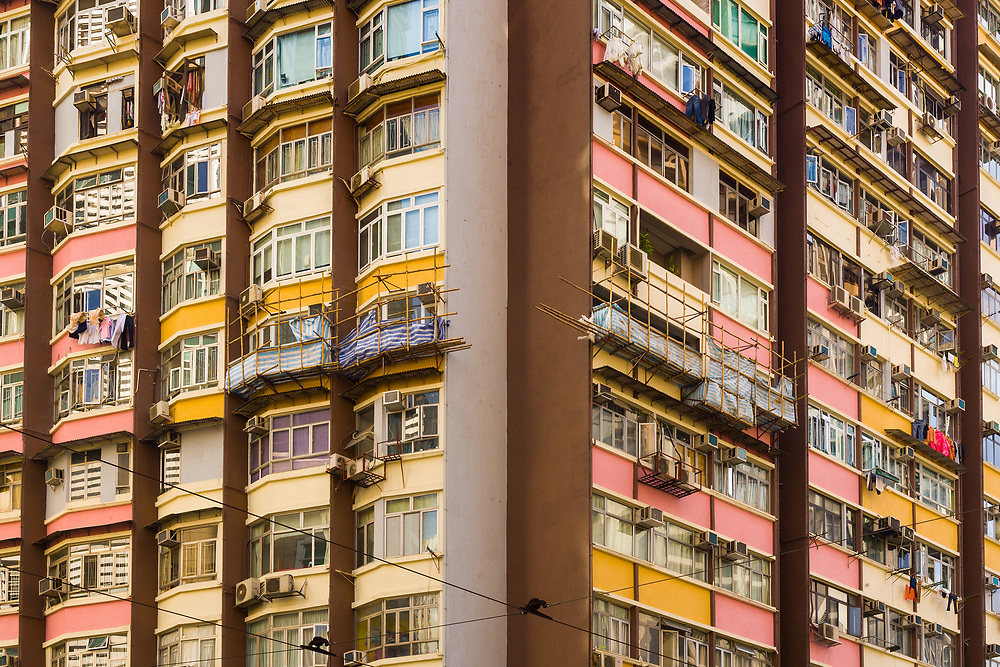 Close-up to a densely populated apartment building in Hong Kong.