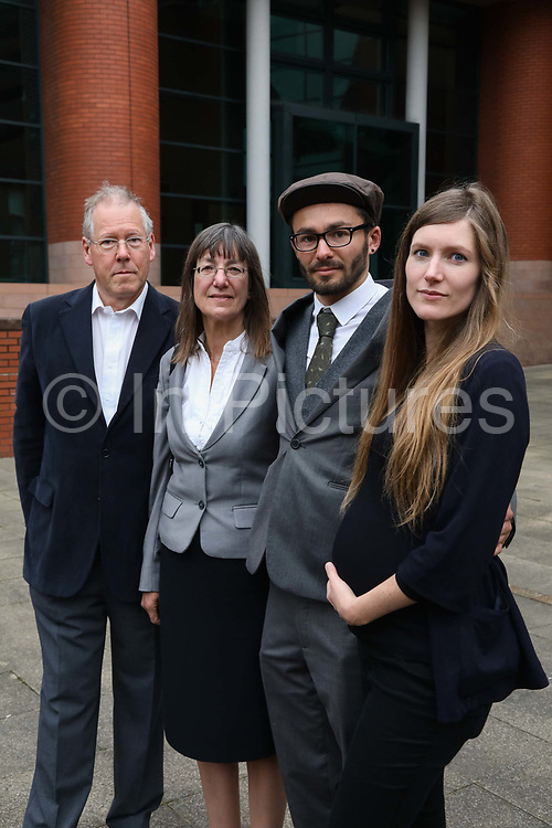 """Simon Roscoe Blevins with his father, mother and sister, Trevor, Rosalind and Fern the morning before sentencing, September 26 2018, Preston crown court,Preston, United Kingdom. Simon Roscoe Blevins, 26,  Richard Roberts, 36 were both sentenced 16 months in prison, Richard Loizou, 31, sentenced 15 months in prison and  and Julian Brock, 47 12 months supended. Simon Roscoe Blevins, 26,  Richard Loizou, 31, Richard Roberts, 36 and Julian Brock, 47 climbed on top of several trucks during a mass protest by locals and supporters in New Preston Road, against fracking in Lancashire, July 2017. The trucks were prevented form delivering equipment to Cuadrillas nearby fracking site for four days. After a seven day jury trial at Preston Crown Court in August 2018, the four men were found guilty of Public Nuisance. Judge Altham has told them to expect """"immediate custodial sentences"""" on 25th September 2018."""
