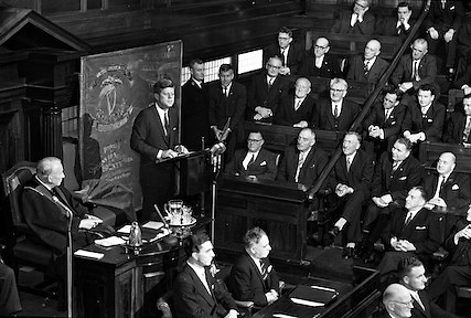 President John F. Kennedy creates history when for the first time a visitor addresses both houses of the Oireachtas, Dáil Éireann, Dublin, Ireland.  It was also the first time that news photos were allowed to be taken during a sitting of the houses.  Members of the government, led by An Taoiseach Seán Lemass, are seated on the left-hand side of the house and the opposition benches are on the right..28.06.1963. Address by the President of the United States of America, John Fitzgerald Kennedy.