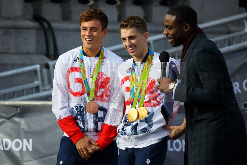© Licensed to London News Pictures. 18/10/2016. London, UK. Bronze medalist diver TOM DALEY and multi-gold medal winner gymnast MAX WHITLOCK speak to the crowd as Olympic and Paralympic athletes, who competed in the Rio 2016 Olympics receive hero's welcome in Trafalgar Square on Tuesday, 10 October 2016. Photo credit: Tolga Akmen/LNP