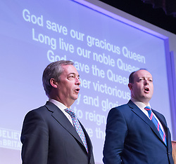 © Licensed to London News Pictures. 28/02/2015. Margate, UK. Nigel Farage sings the National Anthem at the second day of the conference.  The UKIP spring conference at Margate Winter Gardens 28th February 2015. Photo credit : Stephen Simpson/LNP