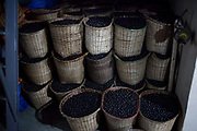 Baskets full of Amazonian Acai berries ready for sale on a boat on the Xingu river in the Amazon region of Brazil