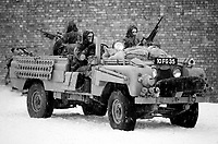 Members of the British SAS Special Air Service with specially adapted land rover and their equipment during a training exercise near the Brecon beacons, Wales in 1970. The build and modification of the car is extremely similar to their SAS forefathers who operated in North Africa in World War Two. Photographed by Terry Fincher