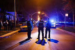 April 24, 2018 - Chicago, IL, USA - Police work the scene where two people were shot near the intersection of 60th and Maplewood Avenue Tuesday April 24, 2018 in Chicago. (Credit Image: © Armando L. Sanchez/TNS via ZUMA Wire)