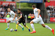 David Silva of Manchester city © goes past Mike van der Hoorn of Swansea city (l). Premier league match, Swansea city v Manchester city at the Liberty Stadium in Swansea, South Wales on Saturday 24th September 2016.<br /> pic by Andrew Orchard, Andrew Orchard sports photography.