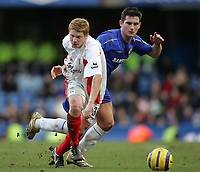 Photo: Lee Earle.<br /> Chelsea v Birmingham City. The Barclays Premiership.<br /> 31/12/2005.<br /> City's Matt Birlby (L) and Frank Lampard battle for the ball.