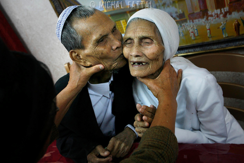 Yaakov (97 years old) and  Ora (84 yeasrs old) Manloon, a married couple of the Jewish immigrants from India, members of the 'Bnei Menashe' community, get married according to the Jewish religion in Kiryat Arba settlement, May 2, 2008. For the last 50 years Bnei Hamenashe seek their roots in Judaism as one of the lost tribes of Israel. Today 7000 Bnei Hamenashe in the States of Manipur and Mizoram in North India live full Jewish lives. Those who immigrate to Israel undergo Orthodox conversion in the framework of which they have to remarry according to Jewish Law... Photo by Michal Fattal.......03/05/2008