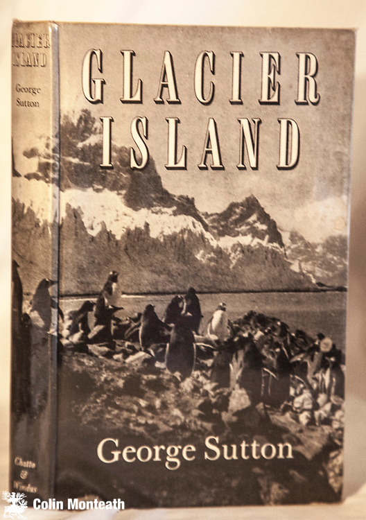 GLACIER ISLAND - SOUTH GEORGIA , George Sutton, Chatto & Windus, London, 1957, 1st Edn., in original blue cloth   dustjacket browned on spine, protected in mylar   B&W plates and good map, previous owner's name stamp on fep, The British South Georgia Expedition 1954-55 was the first expedition to enter the Antarctic regions with mountaineering as its principal objective....climbing first ascents in the Allardyce Range - Hard to find as a First edn.,  $NZ60. (Arnold Heine Collection)