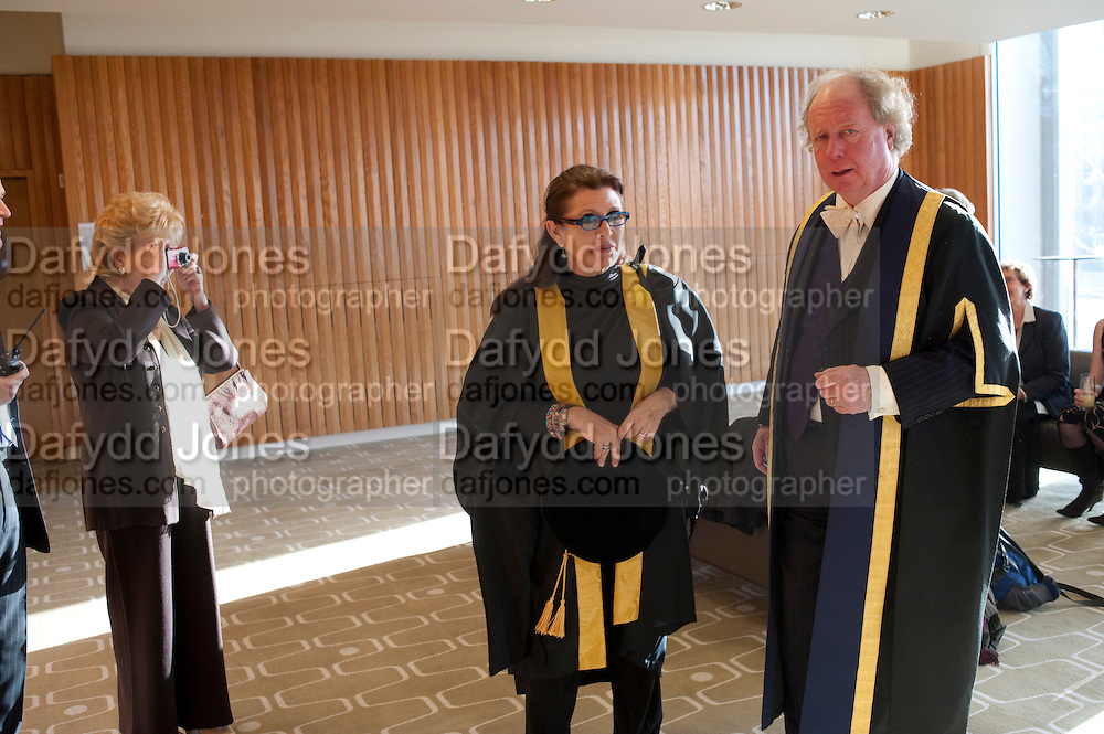 DEBBIE REYNOLDS; CARRIE FISHER; PRINCIPAL GAVIN HENDERSON.   Central School of Speech and Drama presents Honory Fellowships to Carrie Fisher, Bette Bourne, Joseph Selig and Helen Lannaghan. Royal Festival Hall. London. 12 December 2011.