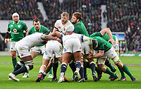LONDON, ENGLAND - MARCH 17: England's George Kruis battles with Ireland's Iain Henderson during the NatWest Six Nations Championship match between England and Ireland at Twickenham Stadium on March 17, 2018 in London, England. (Photo by Ashley Western - MB Media via Getty Images)