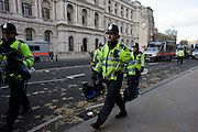 Police bring in riot equipment during students protest against government education cuts in Whitehall. .