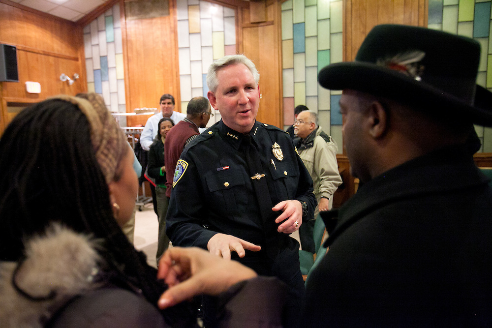 Milton, MA 03/05/2012.Milton Police Chief Richard Wells talks with residents of the River Street neighborhood at the conclusion of a community meeting about increasing violence along Blue Hill Avenue on Monday, March 5 at Concord Baptist Church.