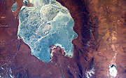 This image captures almost all of Quinghai, the largest lake in China. Located in the Quinghai Province on the Quinghai Tibetan Plateau. February 17, 2000. Satellite image.