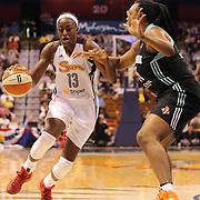 Chiney Ogwumike, (left), Connecticut Sun, drives to the basket past Kara Braxton, Connecticut Sun, during the Connecticut Sun Vs New York Liberty WNBA regular season game at Mohegan Sun Arena, Uncasville, Connecticut, USA. 16th May 2014. Photo Tim Clayton