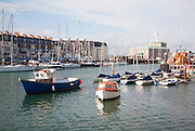 Fishing boats and yachts at moorings in the harbour at Weymouth, Dorset, England, UK